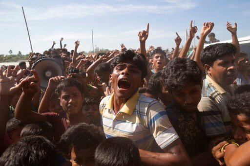 (AP Photo/Dar Yasin, FILE). FILE - In this file photo dated Thursday, Nov. 15, 2018, Rohingya refugees shout slogans during a protest against the repatriation process at Unchiprang refugee camp near Cox's Bazar, in Bangladesh.  Sexual violence carried ...