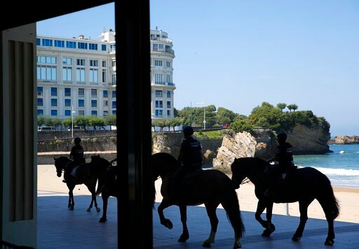 (AP Photo/Francois Mori). Mounted police officers patrol along the beach, with the G7 venue Bellevue in background, Saturday, Aug. 24, 2019 in Biarritz. Leaders of the Group of Seven countries arrive on Saturday to discuss issues including the struggli...