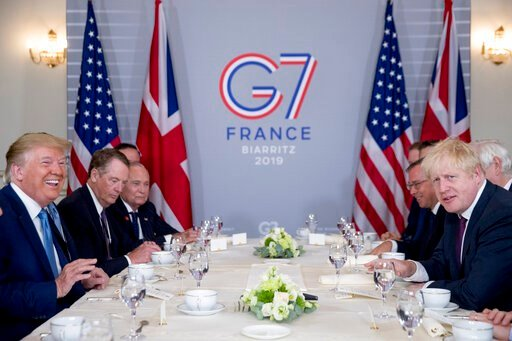 (AP Photo/Andrew Harnik). President Donald Trump and Britain's Prime Minister Boris Johnson, right, attend a working breakfast at the Hotel du Palais on the sidelines of the G-7 summit in Biarritz, France, Sunday, Aug. 25, 2019.