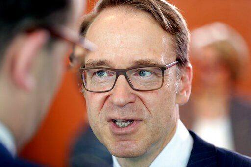 (AP Photo/Michael Sohn, file). FILE -- In this Friday, July 6, 2018 photo Jens Weidmann, president of the Deutsche Bundesbank, talks as he visits a cabinet meeting at the chancellery in Berlin, Germany. The head of Germany's central bank is warning aga...
