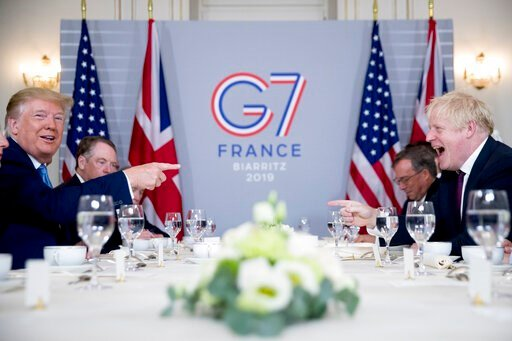(AP Photo/Andrew Harnik). U.S. President Donald Trump, left, and Britain's Prime Minister Boris Johnson attend a working breakfast at the Hotel du Palais on the sidelines of the G-7 summit in Biarritz, France, Sunday, Aug. 25, 2019.