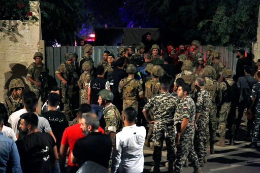 (AP Photo/Bilal Hussein). Lebanese security stand near the site where an Israeli drone was said to have crashed in a stronghold of the Lebanese Hezbollah group, in a southern suburb of Beirut, Lebanon, Sunday, Aug. 25, 2019. A Hezbollah official said S...