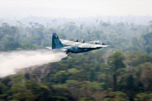(Brazil Ministry of Defense via AP). In this photo released by Brazil Ministry of Defense, a C-130 Hercules aircraft dumps water to fight fires burning in the Amazon rainforest, in Brazil, Saturday, Aug, 24, 2019. Backed by military aircraft, Brazilian...