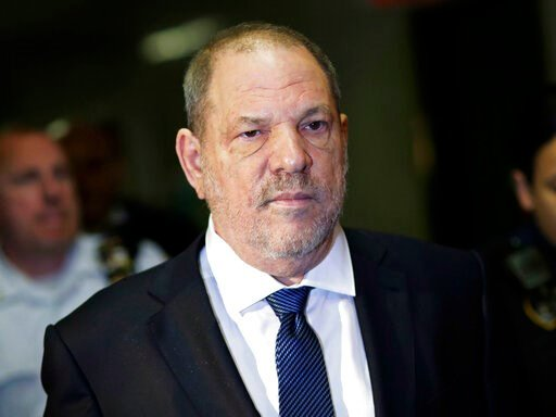 (AP Photo/Mark Lennihan, File). FILE - In this Oct. 11, 2018, file photo, Harvey Weinstein enters State Supreme Court in New York. Weinstein's lawyers want the trial over the sexual assault case against the disgraced movie mogul moved from New York Cit...