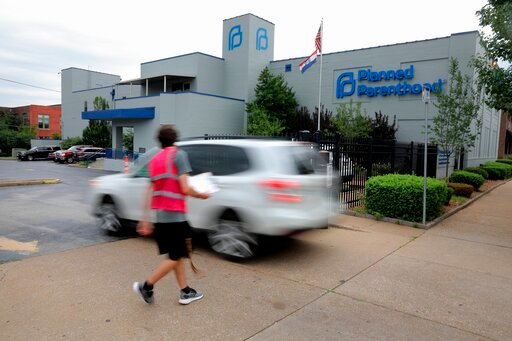 (Christian Gooden/St. Louis Post-Dispatch via AP, File). FILE - In this June 21, 2019, file photo, a motorist enters Planned Parenthood of the St. Louis Region and Southwest Missouri. Critics of new abortion restrictions in Missouri are headed to court...