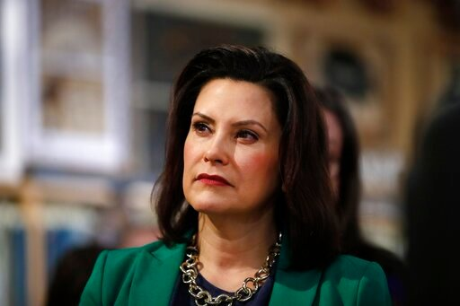 (AP Photo/Paul Sancya, File). FILE - In this March 18, 2019, file photo, Michigan Gov. Gretchen Whitmer listens to Democratic presidential candidate Sen. Kirsten Gillibrand, D-N.Y., in Clawson, Mich. Whitmer is moving to make Michigan the first state t...