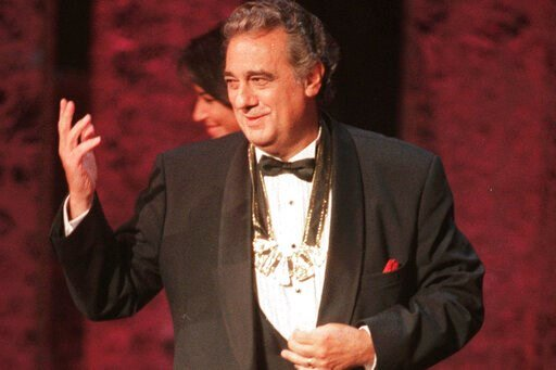 (AP Photo/Leslie Kossoff). FILE - In this Tuesday, Sept. 14, 1999 file photo, Placido Domingo acknowledges the audience after receiving the 1999 Hispanic Heritage Award at the John F. Kennedy Center for the Performing Arts in Washington. An evening bef...