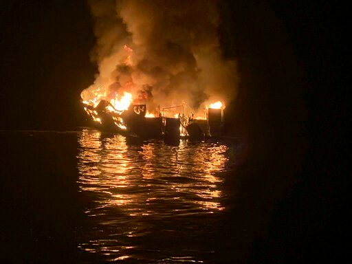 (Santa Barbara County Fire Department via AP, File). FILE - In this Sept. 2, 2019, file photo, provided by the Santa Barbara County Fire Department, a dive boat is engulfed in flames after a deadly fire broke out aboard the commercial scuba diving vess...