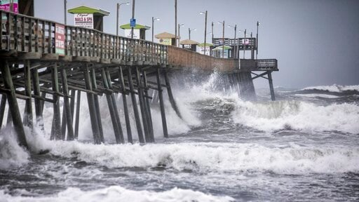 (Julia Wall/The News & Observer via AP). Waves pound the Bogue Inlet Fishing Pier in Emerald Isle, N.C.,as Hurricane Dorian moves north off the coast.