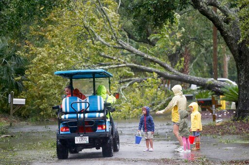 (AP Photo/Mic Smith). Isle of Palms residents look at a downed tree on Hartnett Blvd. during Hurricane Dorian at the Isle of Palms, S.C., Thursday, Sept. 5, 2019, in Charleston, S.C.