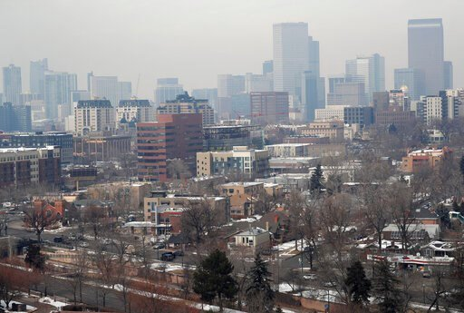 (AP Photo/David Zalubowski, File). FILE - In this March 6, 2019, file photo, as traffic rolls along Speer Boulevard in the foreground, the skyline is shrouded as pollution fills the air in Denver. Colorado has taken the unusual step of inviting the U.S...