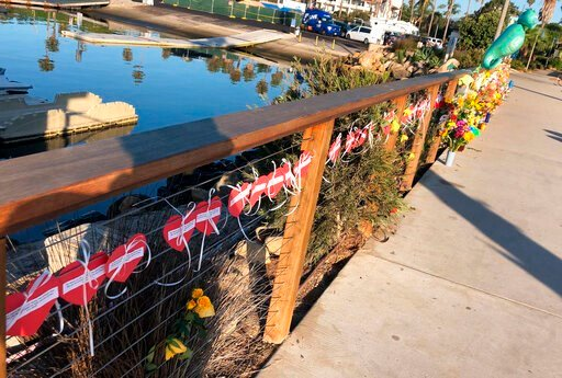 (AP Photo/Stefanie Dazio). A row of hearts, each with the name of a victim, adorn a growing memorial to those who died aboard the dive boat Conception, seen early Friday morning, Sept. 6, 2019 at the harbor in Santa Barbara, Calif. The Sept. 2 fire too...