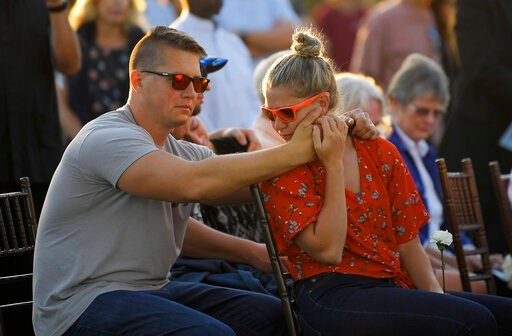 (AP Photo/Mark J. Terrill). Attendees grieve during a vigil Friday, Sept. 6, 2019, in Santa Barbara, Calif., for the victims who died aboard the dive boat Conception. The Sept. 2 fire took the lives of 34 people on the ship off Santa Cruz Island off th...