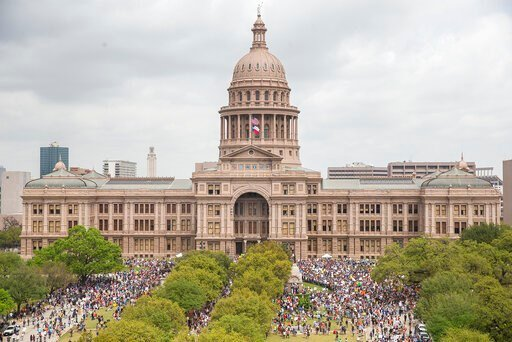 """(Nick Wagner/Austin American-Statesman via AP, File). FILE - In this March 24, 2018, file photo, thousands of people gather on the grounds of the Texas State Capitol during a """"March for Our Lives"""" rally in Austin, Texas.  The vast majority of mass shoo..."""