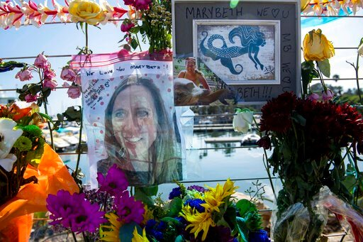 (AP Photo/Christian Monterrosa ). Photographs of loved ones lost in the fire on the scuba boat Conception are placed at a memorial on the Santa Barbara Harbor on Wednesday, Sept. 4, 2019, in Santa Barbara, Calif. A fire raged through the boat carrying ...