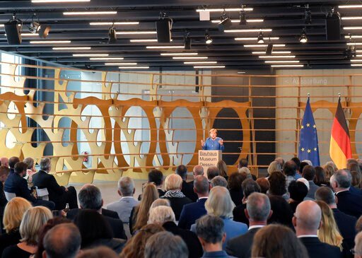 (AP Photo/Jens Meyer). German Chancellor Angela Merkel speaks during the official opening of the new Bauhaus Museum, built for the centenary of the founding of the Bauhaus, in Dessau, Germany Sunday, Sept. 8, 2019.