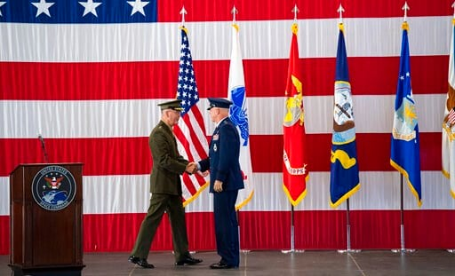 (Christian Murdock/The Gazette via AP). Joint Chiefs of Staff Gen. Joseph F. Dunford, Jr., left, shakes hands with Gen. John W. Raymond, the commander of the U.S. Space Command, Sept. 9, 2019, during a ceremony to recognize the establishment of the Uni...