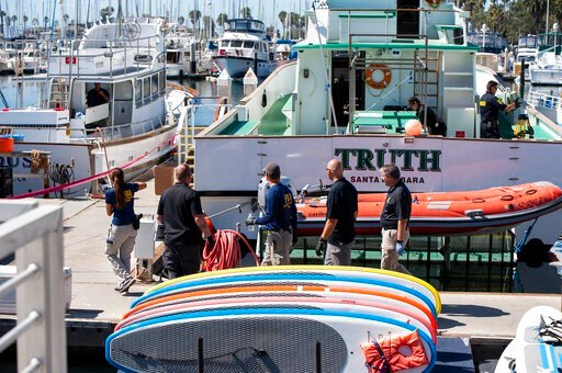 (AP Photo/ Christian Monterrosa). Authorities walk outside the Truth, a Truth Aquatics-owned dive boat, docked in the Santa Barbara Harbor in Santa Barbara, Calif., Sunday, Sept. 8, 2019. Authorities served search warrants Sunday at the Southern Califo...