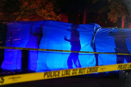 (Anthony Souffle/Star Tribune via AP). Police put up a blue tarp to block the view of a body at the scene of an officer involved shooting  in Richfield, Minn., Saturday night, Sept. 7, 2019. Police near Minneapolis shot and killed a driver following a ...