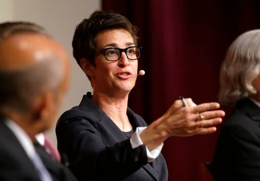 "(AP Photo/Steven Senne, File). FILE - In this Oct. 16, 2017, file photo, MSNBC television anchor Rachel Maddow, host of the Rachel Maddow Show, moderates a panel at a forum called ""Perspectives on National Security"" at the John F. Kennedy School of Gov..."