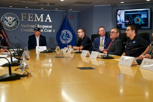 (AP Photo/Jacquelyn Martin). President Donald Trump, left, listens as Kenneth Graham, director of NOAA's National Hurricane Center, on screen, gives an update during a briefing about Hurricane Dorian at the Federal Emergency Management Agency (FEMA), S...