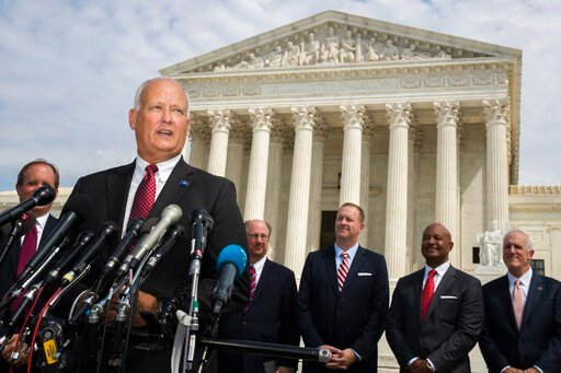 (AP Photo/Manuel Balce Ceneta). Nebraska Attorney General Doug Peterson with a bipartisan group of state attorneys general speaks to reporters in front of the U.S. Supreme Court in Washington, Monday, Sept. 9, 2019. A bipartisan coalition of 48 states ...
