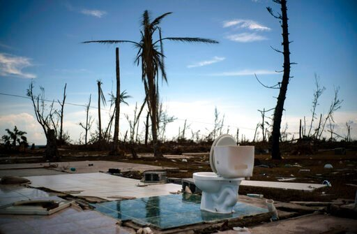 (AP Photo/Ramon Espinosa). A toilet stands amid the rubble of what was once a home after it was destroyed by Hurricane Dorian one week ago in Pelican Point, Grand Bahama, Bahamas, Sunday, Sept. 8, 2019. The toll from the storm in the Bahamas stood at 4...