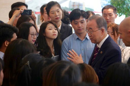 (AP Photo/Sam McNeil). Former U.N. Secretary-General Ban Ki-moon, fourth right, speaks with attendees on the sidelines of a press conference for the release of a report on adapting to climate change in Beijing, Tuesday, Sept. 10, 2019. A group of leade...