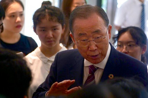 (AP Photo/Sam McNeil). Former U.N. Secretary-General Ban Ki-moon speaks with attendees on the sidelines of a press conference for the release of a report on adapting to climate change in Beijing, Tuesday, Sept. 10, 2019. A group of leaders from busines...