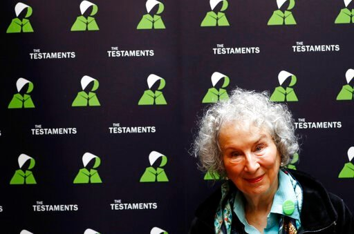 (AP Photo/Alastair Grant). Canadian author Margaret Atwood poses for a photograph during a press conference at the British Library to launch her new book 'The Testaments' in London, Tuesday, Sept. 10, 2019.