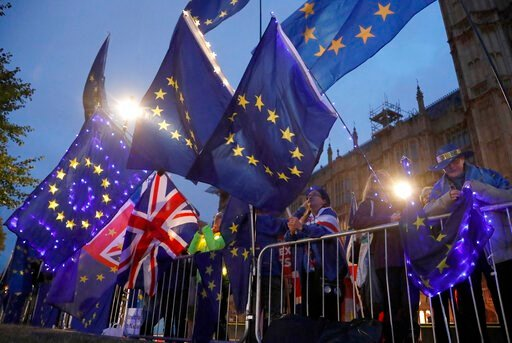 (AP Photo/Frank Augstein). Pro EU protestors wave flags opposite parliament in London, Monday, Sept. 9, 2019. British Prime Minister Boris Johnson voiced optimism Monday that a new Brexit deal can be reached so Britain leaves the European Union by Oct....