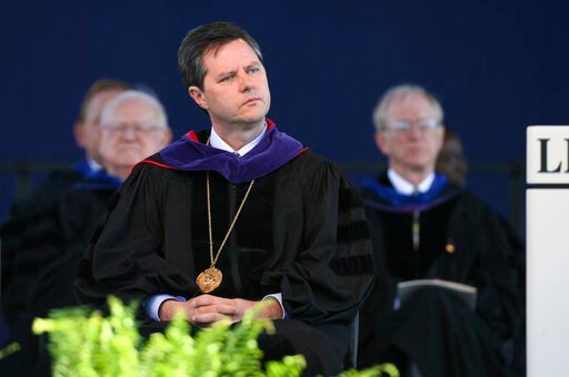 (Stephanie Klein-Davis/The Roanoke Times via AP). FILE - In this May 19, 2007, file photo, Jerry Falwell, Jr. listens before speaking for the first time as chancellor of Liberty University at the school's graduation ceremony  in Lynchburg, Va. Falwell ...