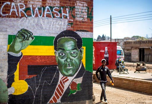 (AP Photo/Ben Curtis). A man walks past a mural of former president Robert Mugabe, in the low income neighbourhood of Mbare, known to have many supporters of Mugabe's ZANU-PF party, in the capital Harare, Zimbabwe Monday, Sept. 9, 2019. Mugabe, who enj...