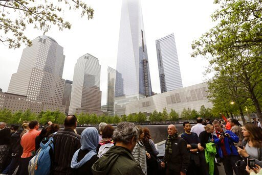 (AP Photo/Frank Franklin II). FILE- In this May 15, 2015 file photo, visitors gather near the pools at the 9/11 Memorial in New York. As they have done 17 times before, a crowd of victims' relatives is expected at the site on Wednesday, Sept. 11, 2019 ...