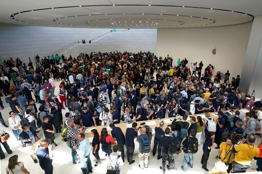 (AP Photo/Tony Avelar). Event attendees get a look at the new products at the Steve Jobs Theater during an event to announcement Tuesday, Sept. 10, 2019, in Cupertino, Calif.