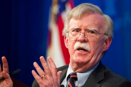 (AP Photo/Cliff Owen, File). FILE - In this Dec. 13, 2018 file photo, national security adviser John Bolton unveils the Trump Administration's Africa Strategy at the Heritage Foundation in Washington.