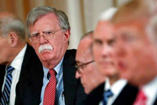 (AP Photo/Pablo Martinez Monsivais). FILE - In this April 18, 2018 file photo, National security adviser John Bolton, left, listens to President Donald Trump, far right, speak during a working lunch with Japanese Prime Minister Shinzo Abe at Trump' s p...