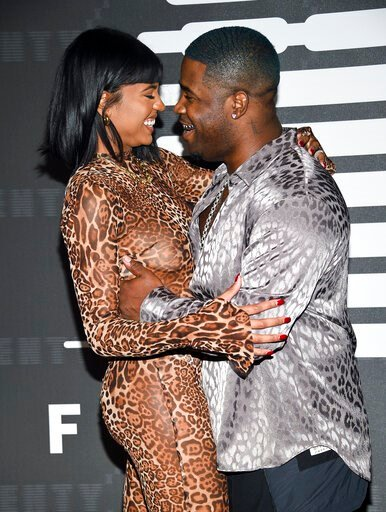 (Photo by Evan Agostini/Invision/AP). Rapper A$AP Ferg, right, and girlfriend Renell Medrano attend the Spring/Summer 2020 Savage X Fenty show, presented by Amazon Prime, at the Barclays Center on Tuesday, Sept, 10, 2019, in New York.