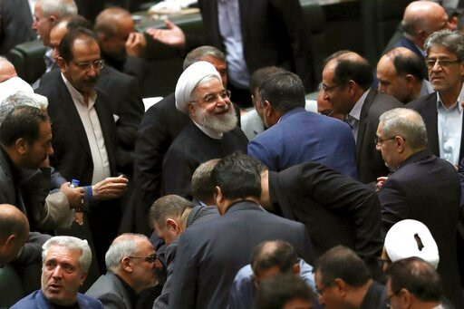 (AP Photo/Vahid Salemi). Iranian President Hassan Rouhani, center, listens to a lawmaker after defending his proposed tourism and education ministers, in Tehran, Iran, Tuesday, Sept. 3, 2019. Rouhani said European nations are failing to implement their...