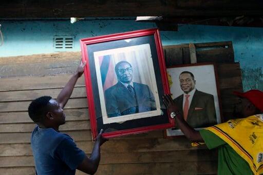(AP Photo/Tsvangirayi Mukwazhi). Supporters of Former Zimbabwean President Robert Mugabe place his portrait next to that of Zimbabwean President Emmerson Mnangagwa in Harare, Tuesday, Sept, 10, 2019. Mugabe who died aged 95 in Singapore, is expected to...