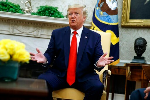 (AP Photo/Evan Vucci). President Donald Trump talks about a plan to ban most flavored e-cigarettes, in the Oval Office of the White House, Wednesday, Sept. 11, 2019, in Washington.