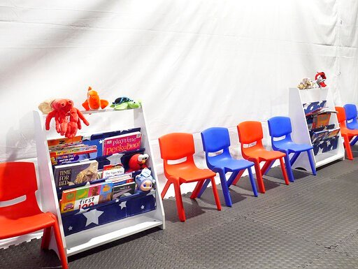 (Ricardo Santos/The Laredo Morning Times via AP). Stuff animals, story books and small chairs fill the Juvenile waiting area at the Migrant Protection Protocols Immigration Hearing Facilities in Laredo, Tuesday, September 10, 2019. The facility is sche...