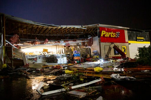 (Abigail Dollins/The Argus Leader via AP). In this Tuesday, Sept. 10, 2019 photo, debris litters the ground at Advance Auto Parts following severe weather in Sioux Falls, S.D.