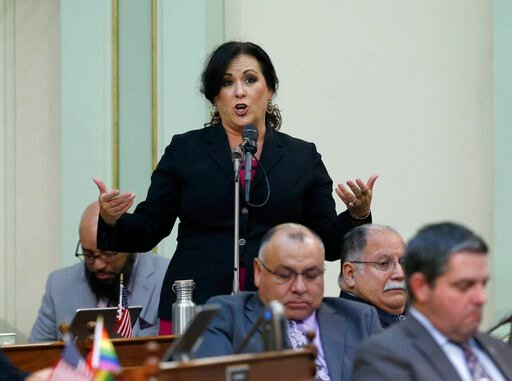 (AP Photo/Rich Pedroncelli). Assemblywoman Lorena Gonzalez, D-San Diego, urges lawmakers to approve her measure to give new wage and benefit protections at the so-called gig economy companies like Uber and Lyft, during the Assembly session in Sacrament...