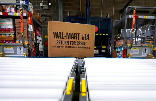 (AP Photo/David J. Phillip, File). FILE - In this Nov. 9, 2018, file photo, a box of merchandise is unloaded from a truck and sent along a conveyor belt at a Walmart Supercenter in Houston. Walmart is rolling out an unlimited grocery delivery subscript...