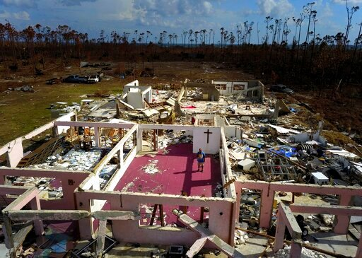"""(AP Photo / Ramon Espinosa). Pastor Jeremiah Saunders poses for a photo among the ruins of his church that was destroyed by Hurricane Dorian, in High Rock, Grand Bahama, Bahamas, Wednesday Sept. 11, 2019. Jeremiah says """"I spoke to the water: 'Peace, be..."""