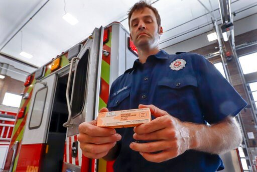 (AP Photo/Keith Srakocic). In this Sept. 11, 2019, photo, Akron fire medic Paul Drouhard shows a box containing naloxone that is carried in all the department's emergency vehicles. The drug commonly called Narcan is used primarily to treat narcotic ove...