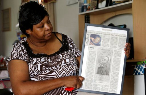 (AP Photo/Gerry Broome). In this photo taken Tuesday, Aug. 6, 2019 Brenda Scurlock is shown in her home in Lumber Bridge, N.C. holding a newspaper clipping about her son's murder. Scurlock's son Avery Scurlock, who used the name Chanel when dressing as...