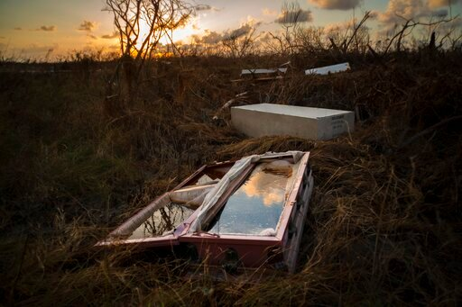 (AP Photo/Ramon Espinosa). A shattered and water-filled coffin lays exposed to the elements in the aftermath of Hurricane Dorian, at the cemetery in Mclean's Town, Grand Bahama, Bahamas, Wednesday Sept. 11, 2019. Bahamians are tackling a massive clean-...