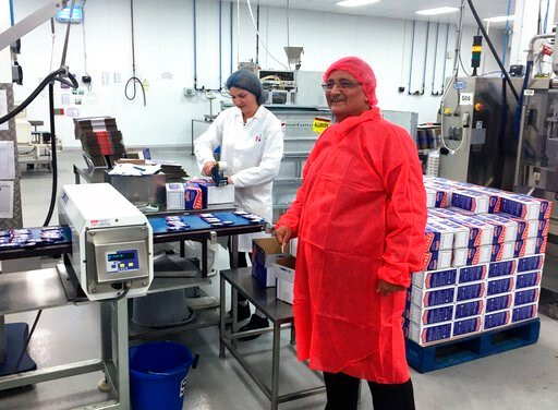 (AP Photo/Jeff Schaeffer). In this photo taken on Tuesday, Sept. 10, 2019, Kamal Dhutia, managing director of B I Europe Limited, a family-run firm of about 50 workers, is seen in his factory in Loughborough, England. Britain hasn't left the European U...